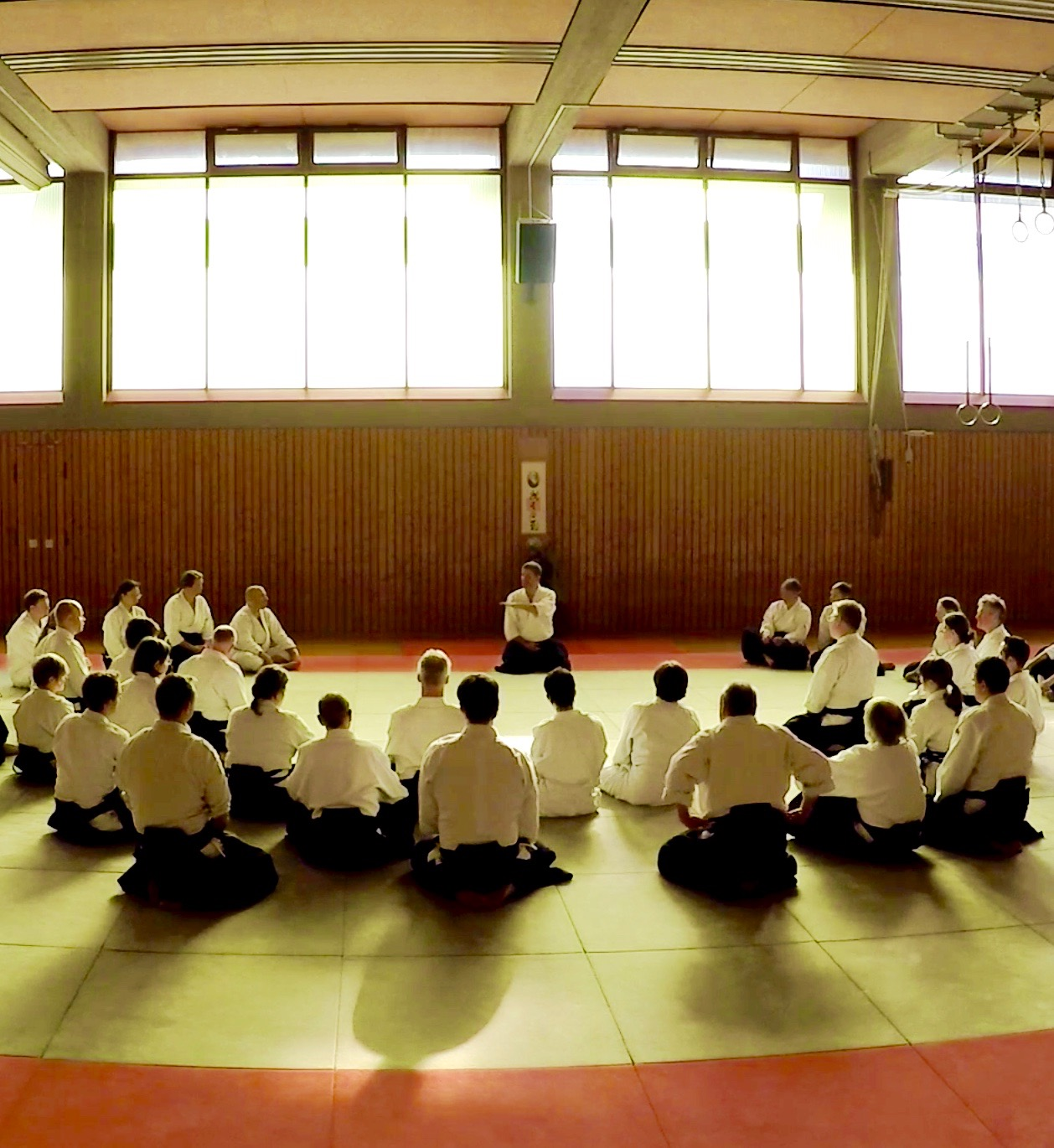 Aikido students listen to Kessler Sensei at seminar